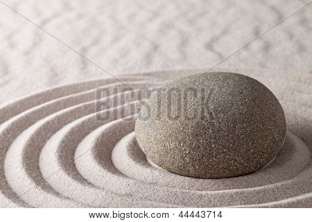 Zen meditation garden lines and patterns with sand and stones Japanese purity relaxation harmony spirituality and serenity concept