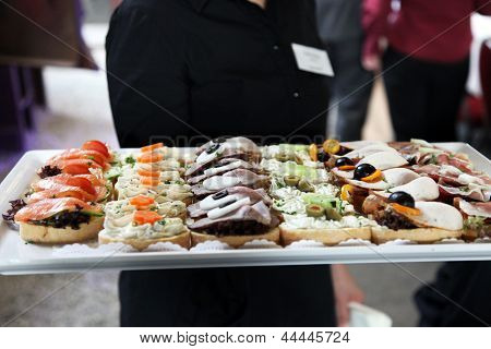 Waiter Offering A Tray Of Appetizers