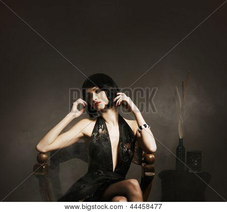 Retro image of beautiful brunette woman in vintage dress