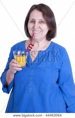 Elderly Woman Drinks Orange Juice