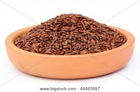 Flax or edible tisi seeds on a clay pottery poster