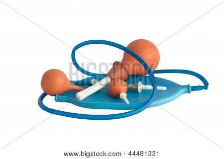 Some enemas and syringes on white background poster
