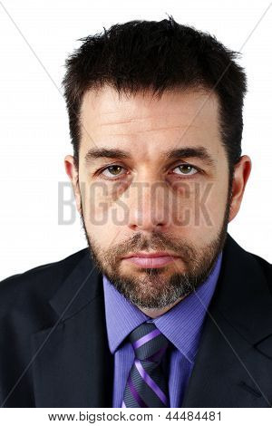 Portrait Of Unhappy Man In Suit