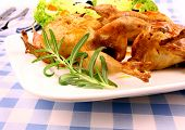 Fried quail with gravy rosemary garlic and salat poster