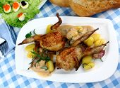 Two fried quail with gravy gnocchi rosemary caviar salad top view poster