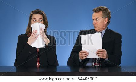 Male newscaster looking at female co-worker as if she has said something terrible.