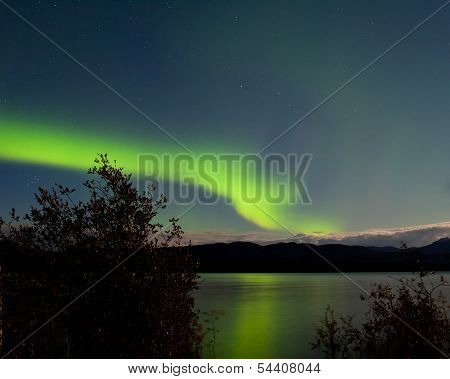Aurora Borealis Reflected On Lake Laberge Yukon