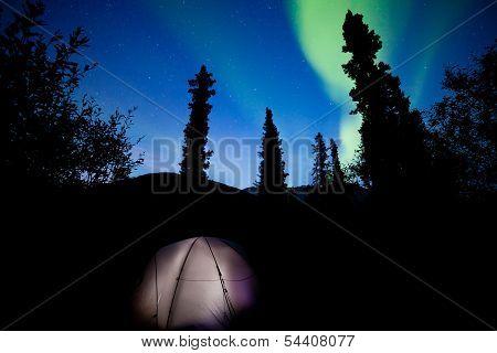 Taiga Tent Illuminated Under Northern Lights Flare