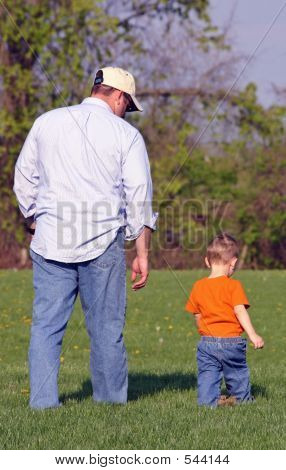 Father  And Son Walking In Park
