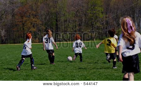 Girls Soccer  Team Taking Ball Downfield