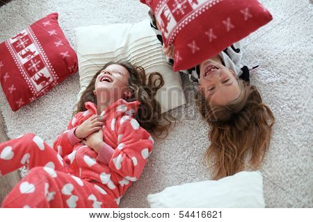 Children in soft warm pajamas playing at home