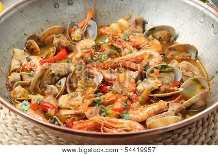 Traditional portuguese seafood dish - cataplana-The cooking process used by the CATAPLANA prevents the loss of the ingredients' aromas, ensuring full and excellent flavor.