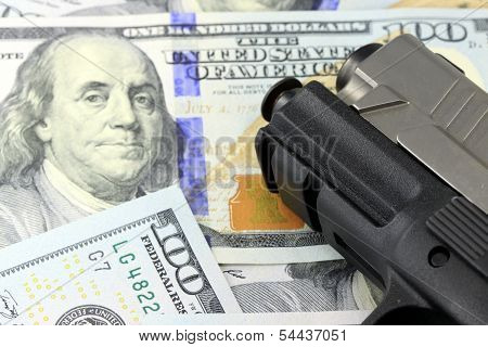 Hand Gun with American Currency