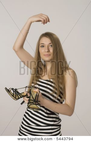Girl  By Black Sandals In A Hand