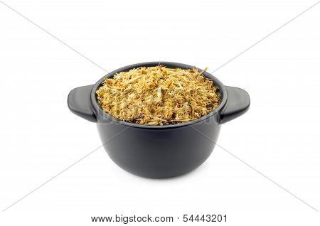 Dry Chamomile In A Black Cup