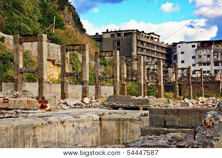 Abandoned island of Gunkanjima off the coast of Nagasaki, Japan. The island was populated as a coal mining town from 1887 but was abruptly abandoned in 1974.