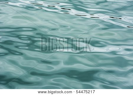 poster of Water ripples on a cloudy day creating pattern on water surface