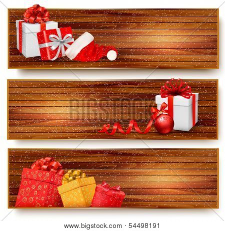 Three christmas banners with gift boxes and santa hat. Raster version