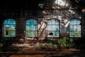 Photo Of An Abandoned Industrial Interior With Bright Light poster