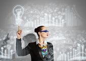 Image of businesswoman in goggles with business sketch at background. Idea concept poster
