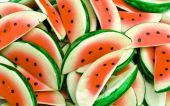 Pile of small watermelon slice painted magnets poster