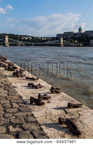 Shoes symbolizing the massacre of people shot at the river Danube in Budapest poster