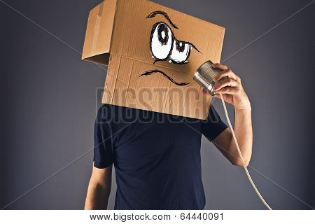 Man With Cardboard Box On His Head Using Tin Can Telephone
