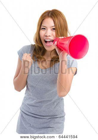 Woman shouting through loudspeaker