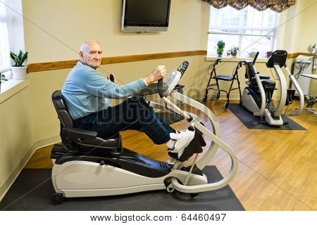 Physical Therapy Patient On Recumbent Stepper