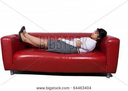 Businesswoman sleeping on sofa