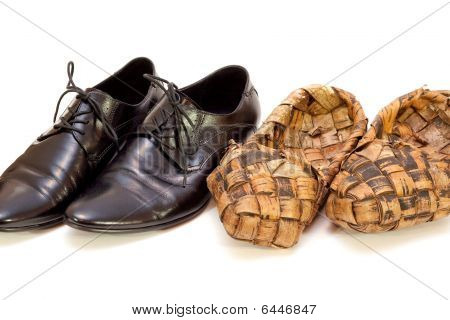Russian Bast Shoes And Man's Shoes On A White Background