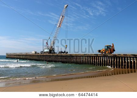 Mobile Crane And Pay Loader On Pier Construction Site