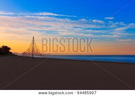 Denia las Marinas beach les Bovetes at sunset in Alicante Mediterranean Spain