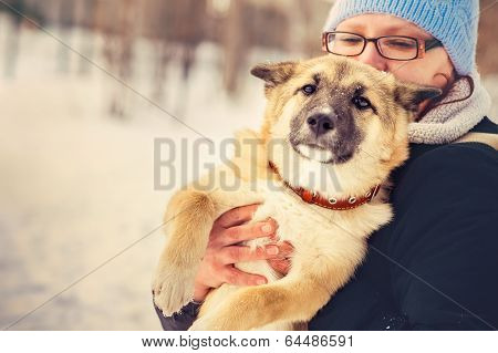 Dog Shepherd Puppy and Woman hugging Outdoor Lifestyle and Friendship concept poster