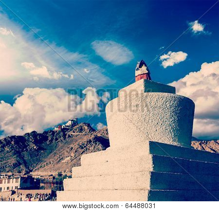 Vintage retro effect filtered hipster style travel image of Whitewashed chorten and Tsemo fort and gompa. Leh, Ladakh, India