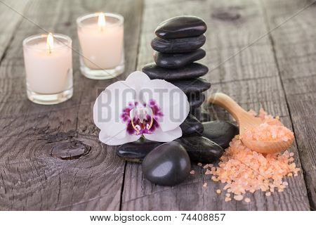 White Moth Orchid And Orange Bath Salt On Weathered Deck