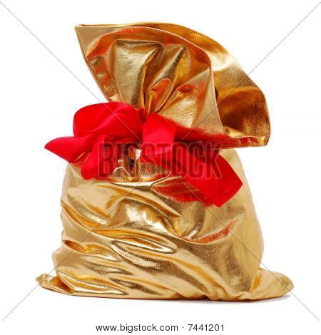 Gold Gift Bag Tied With Red Ribbon