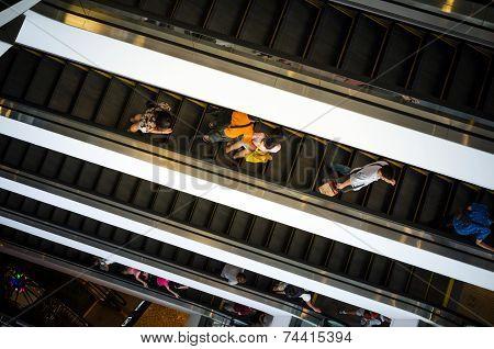 Bangkok, Thailand - September 12, 2013: Shoppers On Escalator At Terminal21 Shopping Mall