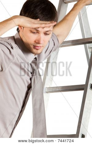 Young Businessman Climbink In Ladder And Looking Down. Isolated