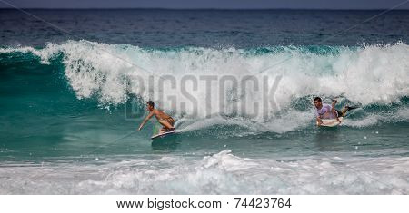 Two Bodyboarders Riding Together