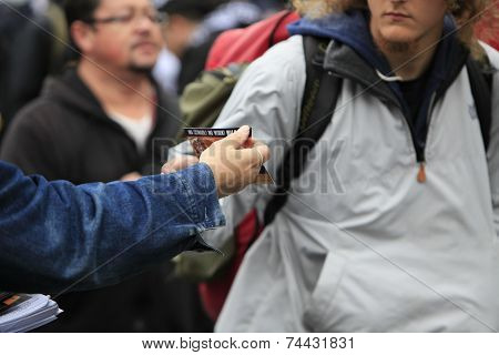 Passerby accepting handout