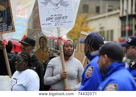 Ellisha Flagg (with sign) marching