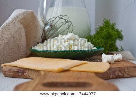Sandwiches With Cheese, Dill, A Parsley, A Jug Of Milk, Curd In A Plate