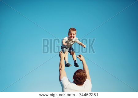 Happy Joyful Child, Father Fun Throws Up Son In The Air, Summer, Sun, Blue Sky, Family, Travel, Vaca