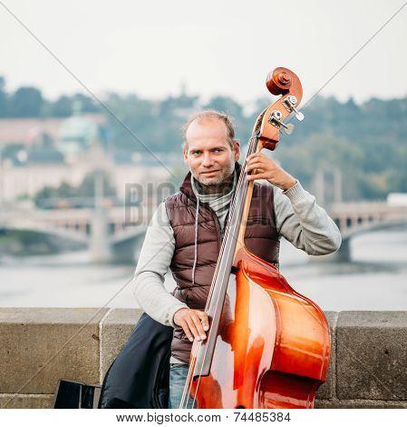 Street Busker Performing Jazz Songs On The Charles Bridge In Prague