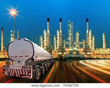 Petroleum Container Truck And Beautiful Lighting Of Oil Refinery Plant In  Heav Petrochemicaly Indus