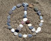 stones on the beach in the form with meaning peace and love poster