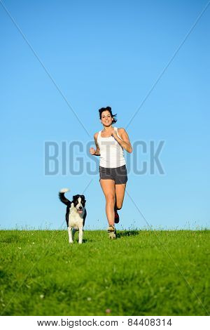 Sporty Happy Woman Running With Dog