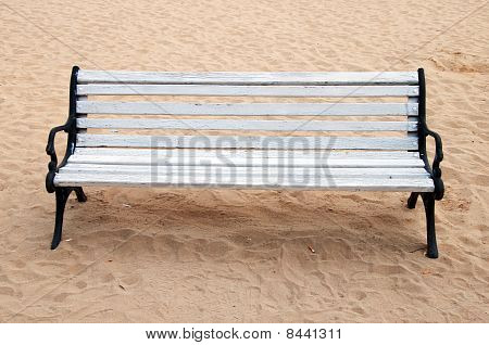 Wooden Bench And Butts Over The Sand
