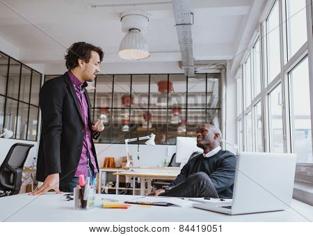 Two Young Office Workers Having A Casual Meeting